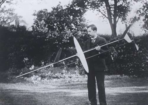 Frederick Lanchester with one of his model gliders used to make aerodynamic measurements, 1894 [LAN/7/4].