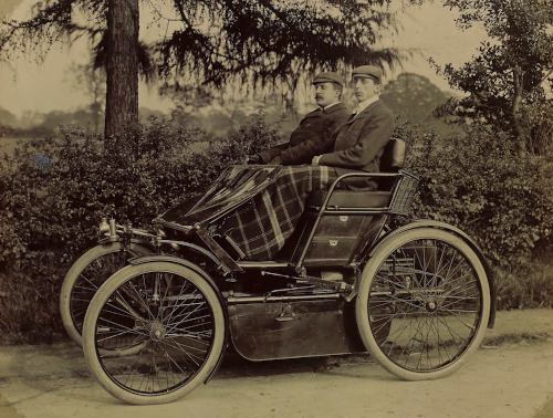 Frederick Lanchester at the wheel of the 8 h.p. two cylinder Lanchester car known as the 'Gold Medal Phaeton' with his brother George as passenger, c1899 [LAN/1/16/4].