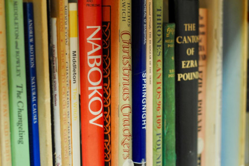 Detail of books within the Poetry / Drama section of the Burgess Foundation's reading room in Manchester